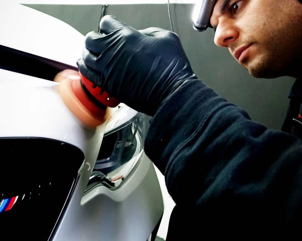 A Buff and Beyond Detailer carrying out a paint correction polish on a BMW M2